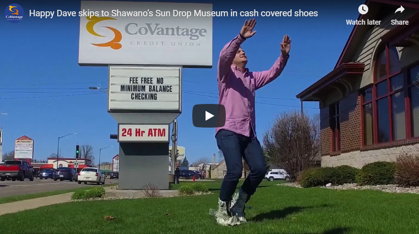 Happy Dave skips to Shawano's Sun Drop Museum in cash covered shoes