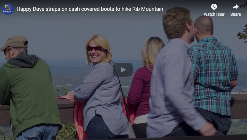 Happy Dave straps on cash covered boots to hike Rib Mountain