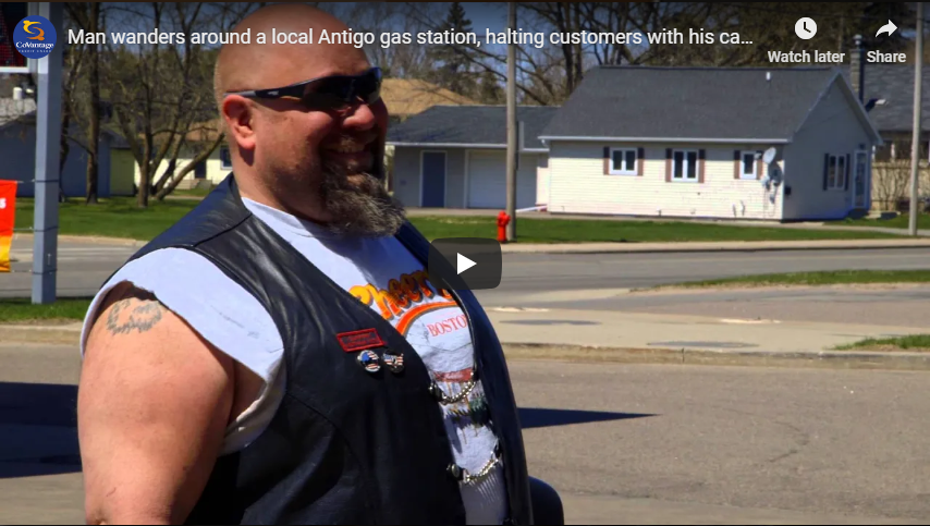 Happy Dave wanders around a local Antigo gas station, halting customers with his cash covered shoes.