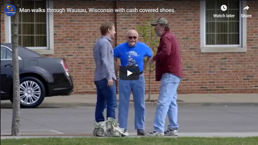 Happy Dave walks through Wausau, Wisconsin with cash covered shoes.