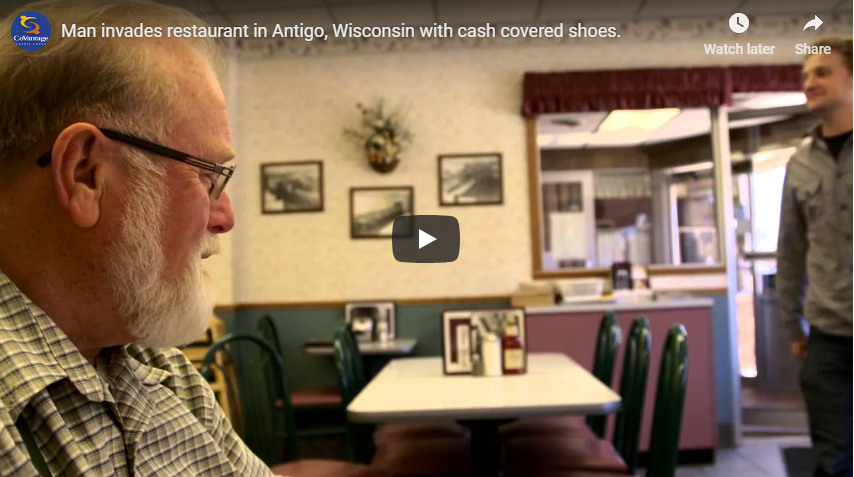 Happy Dave invades restaurant in Antigo, Wisconsin with cash covered shoes.