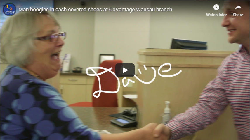 Happy Dave boogies in cash covered shoes at CoVantage Wausau branch