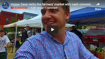 Happy Dave visits the farmers' market with cash covered shoes